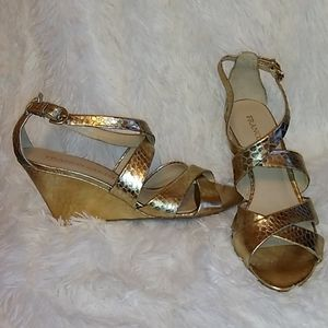 Women's gold sandals by Franco Sarto